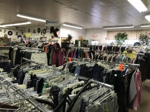 Racks of womens clothes for sale at Sauk Centre STEP