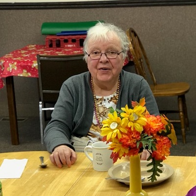 An older woman enjoys a cup of coffee at STEP's Activity and Senior Center in Browerville, MN.